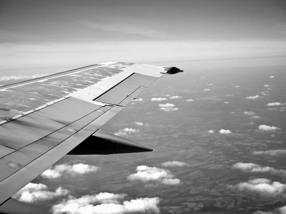 airplane wing flying sky above the clouds overhead view aerial