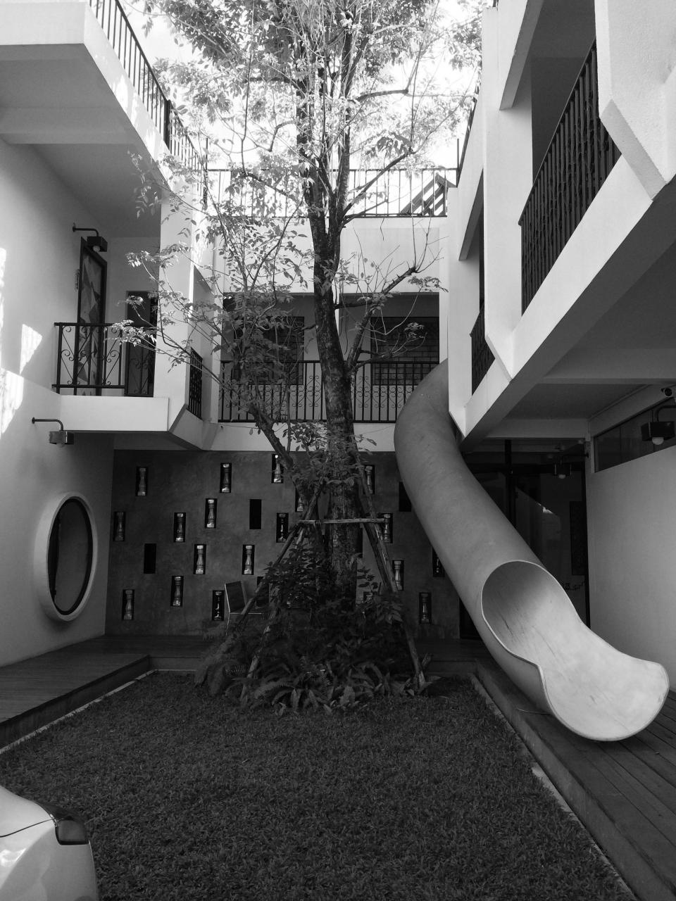 hotel slide architecture balcony balconies chiang mai thailand black and white tree