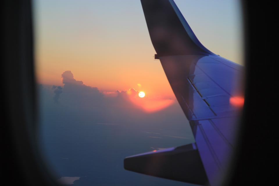 airplane travel adventure plane vacation trip transportation vehicle sun clouds sky wing