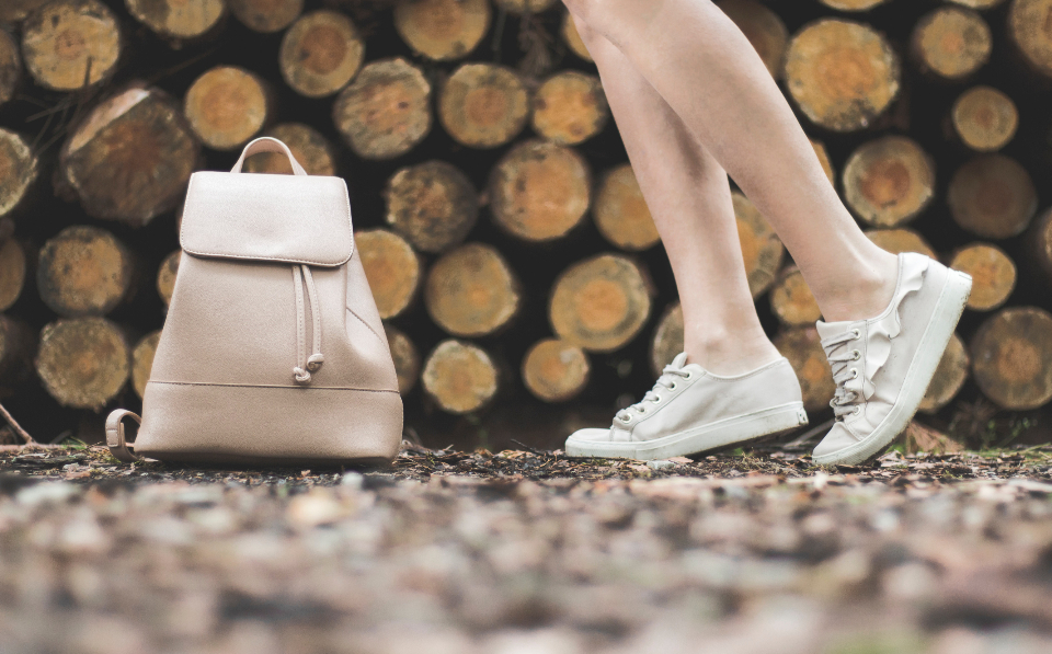 woman white shoes handbag stack logs forest wood cut walk dance legs