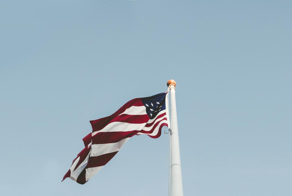 blue sky american flag USA united states pole