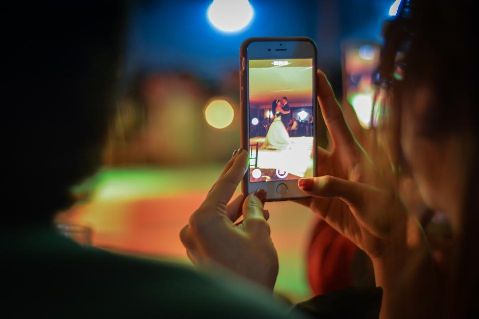mobile phone camera picture capture woman girl lady bokeh lights people blur dancing iphone