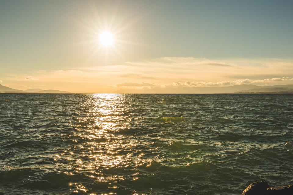 nature water ocean sea waves splash surface reflection sky clouds horizon sun sunset sunrise