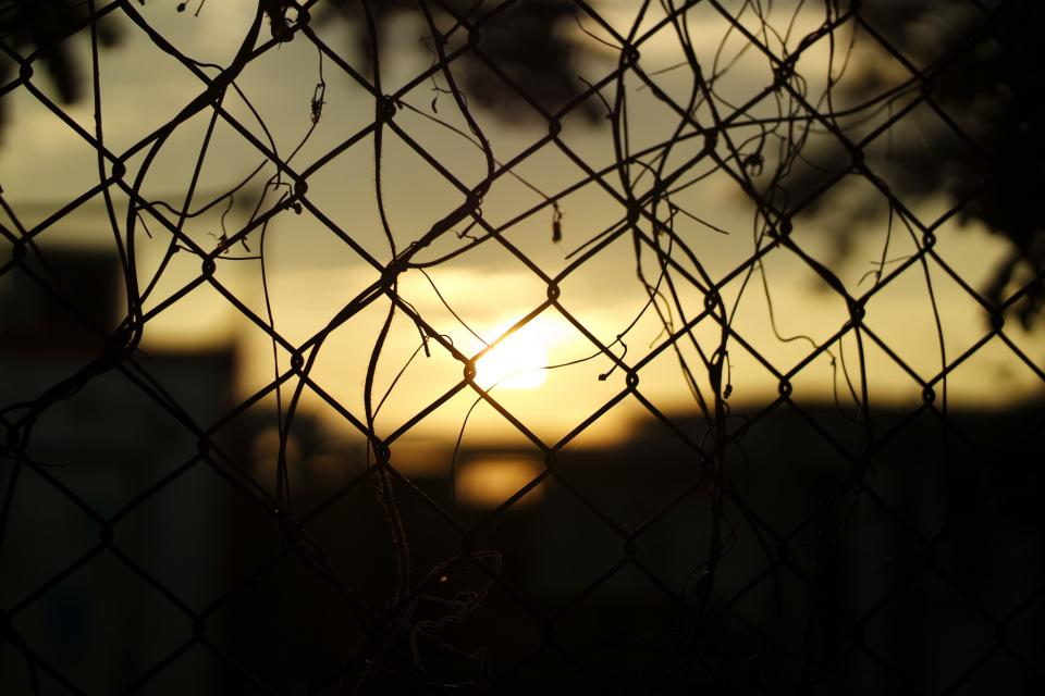 sunset barrier wire dark silhouette shadow