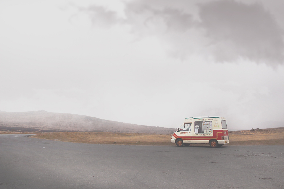 ice cream truck desolate road clouds sky moor hill nature