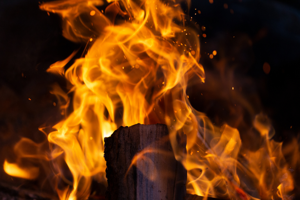 camp fire sparks wood nature hot flames orange yellow night outdoors