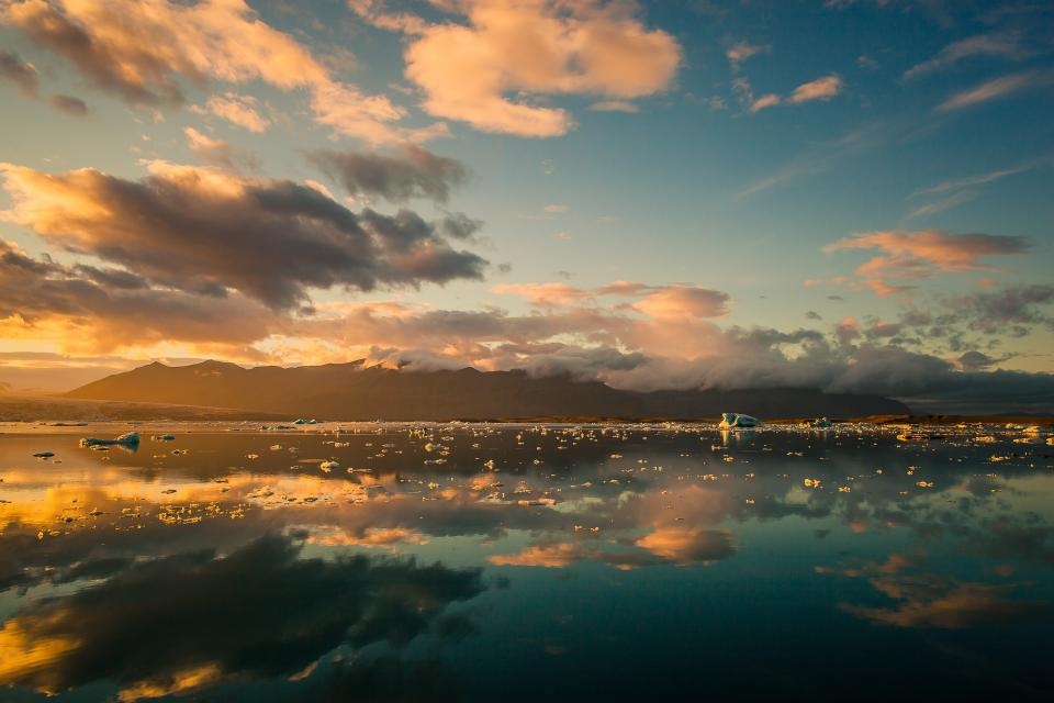 nature landscape reflection clouds sky ocean sea mountain water