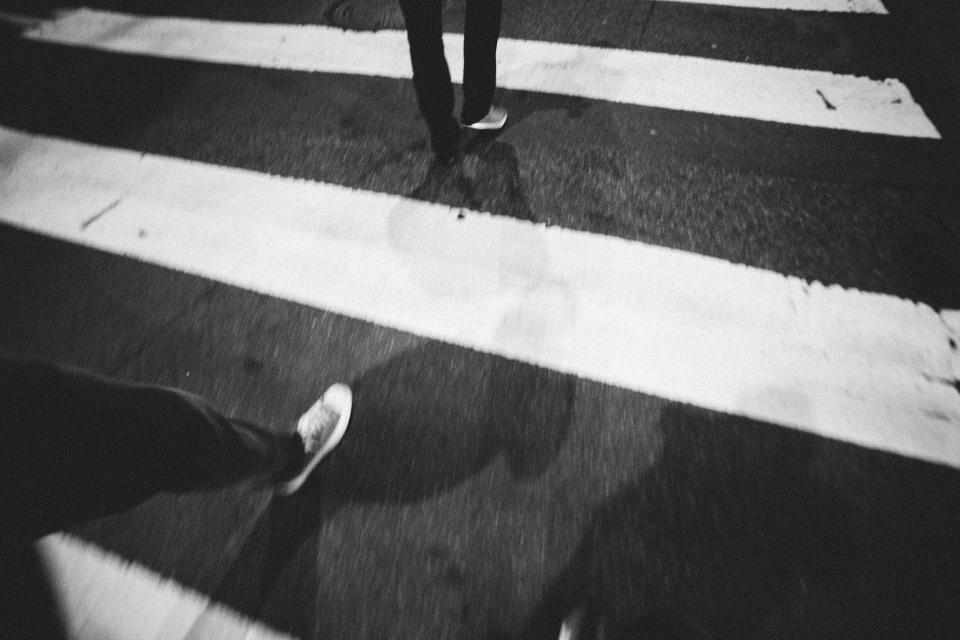 crosswalk street pavement shoes shadows night evening