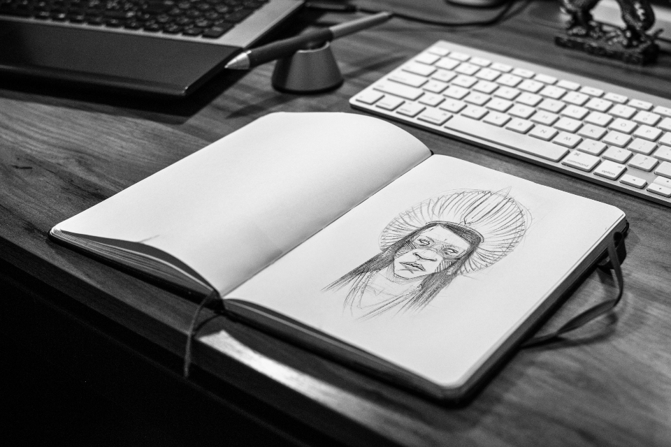 designer sketch notepad pencil pen sketching desk office keyboard laptop computer illustration wood