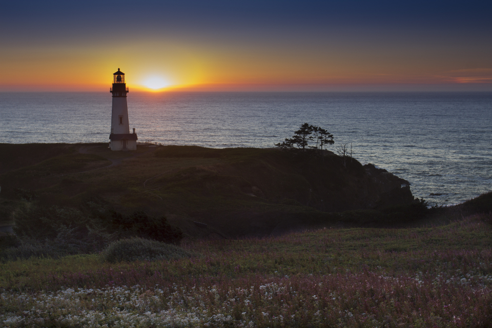 lighthouse landscape sunset ocean sea shore coast nature landmark sunrise dusk dawn island horizon beacon