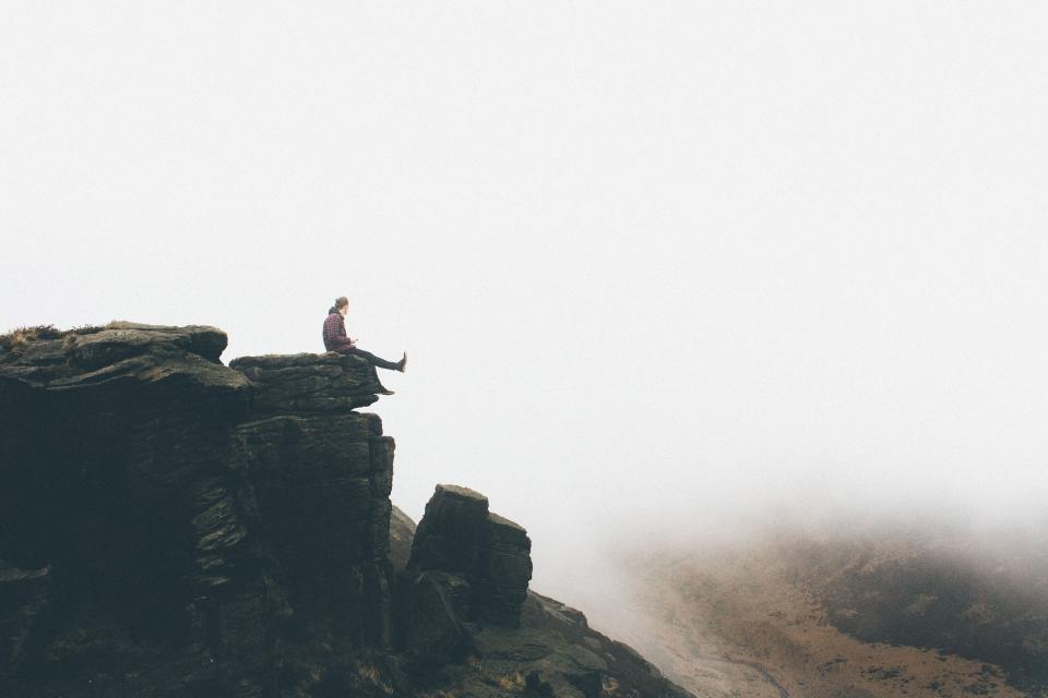 highland cliff rock hill travel alone people man hiking climbing fog adventure view chill relax