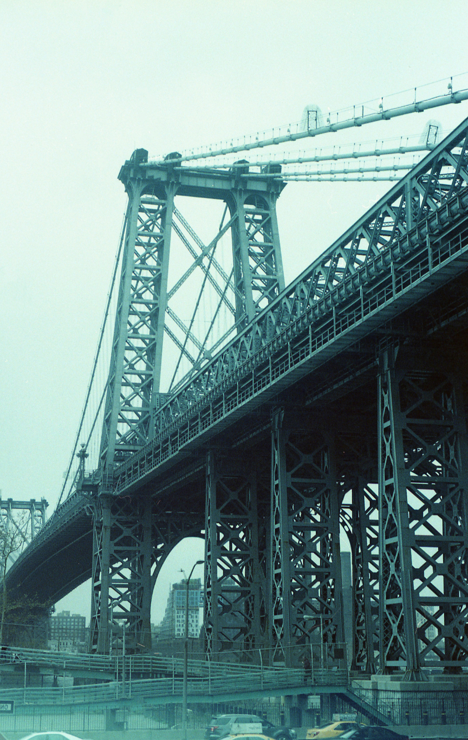 bridge sky suspension travel new york city overcast cloudy buildings tall view urban road city architecture vintage grainy