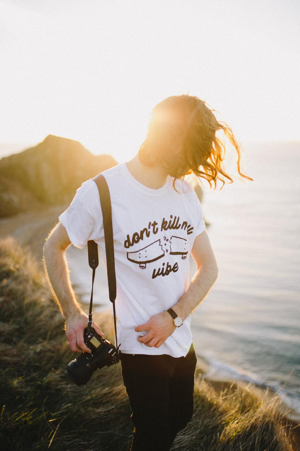 grass blur coast sea water sunrise sunlight people man guy camera strap photographer