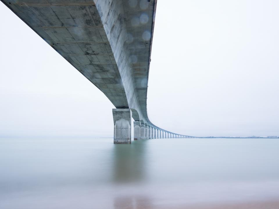architecture bridges structures steel concrete industrial patterns perspective nature water river sea calm serene
