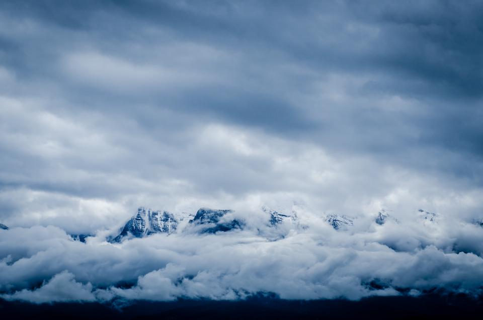 nature landscape mountains summit peaks snow sky clouds blanket blue white majestic