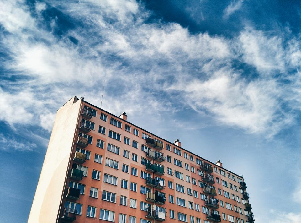 building apartment windows city architecture blue sky clouds