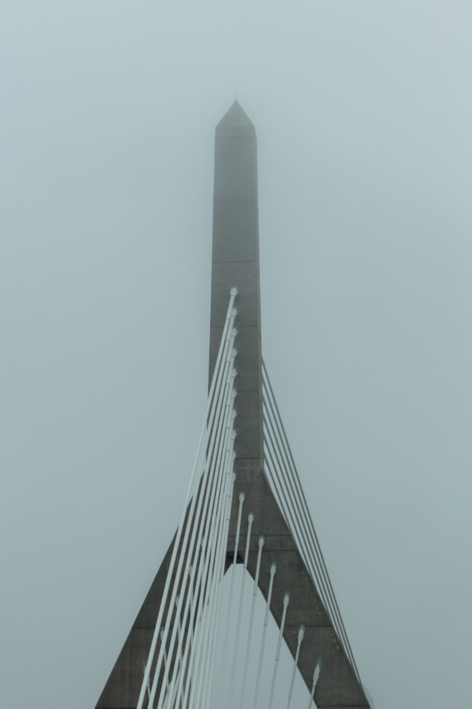 bridge city angle architecture structure modern cable lines tower sky clouds design fog weather misty abstract moody