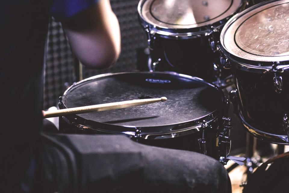 still items things music instrument drums set drummer drumsticks man male person musician bokeh