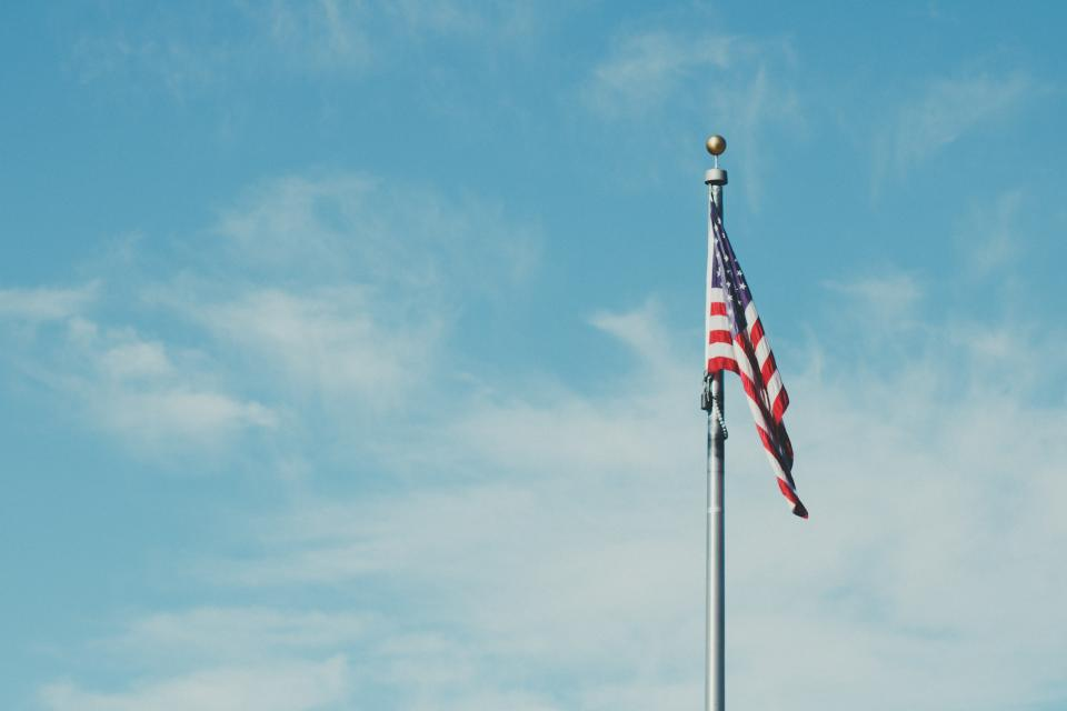 usa flag pole blue sky cloud