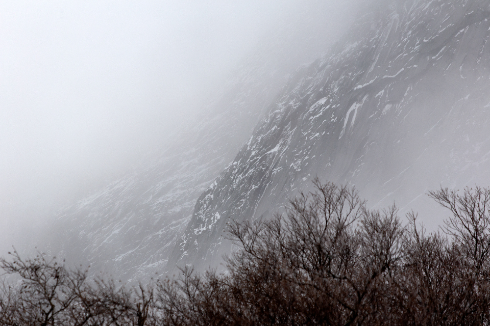snow rock cliffs winter ice cold clouds fog nature outdoors misty mountain landscape scenic