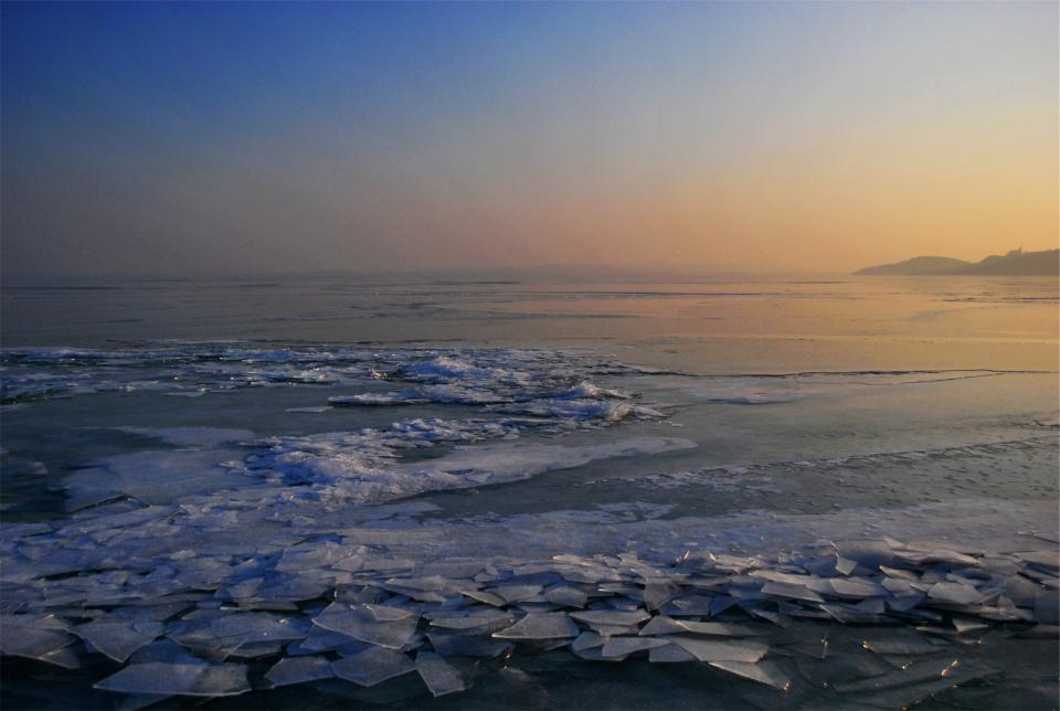 sunset dusk ice frozen freezing lake water