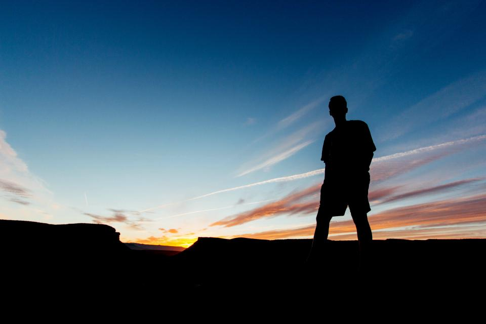 guy man male people stand nature sky clouds fiery horizon dusk dawn light shadows silhouette travel trek