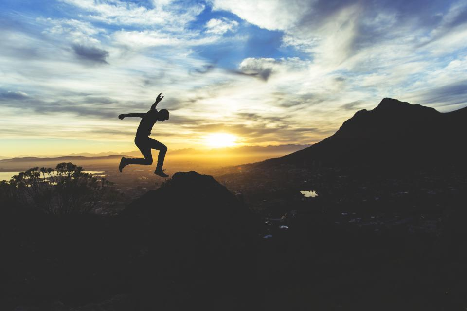sunset silhouette jumping guy man people landscape mountains hills dusk sky clouds adventure