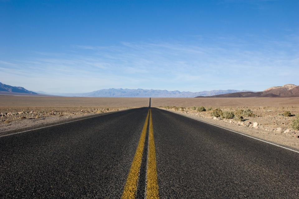 highway road pavement desert dirt landscape nature outdoors mountains blue sky sunshine