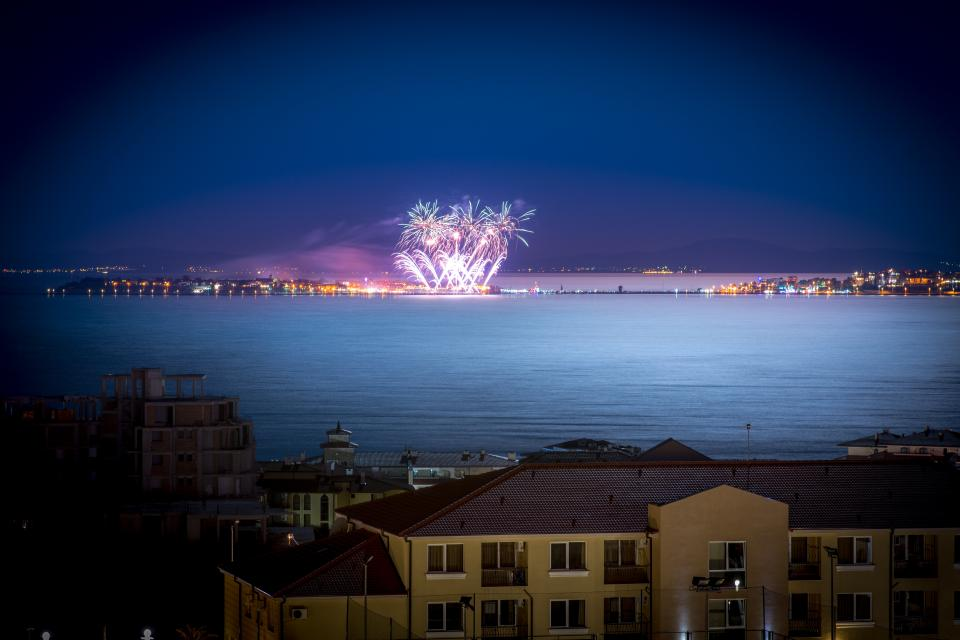 architecture building infrastructure blue sky dark night lights sea water ocean fireworks party celebration
