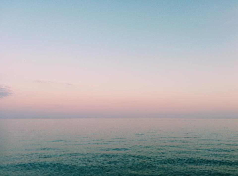 nature water ocean sea surface still calm gradient blue pink purple