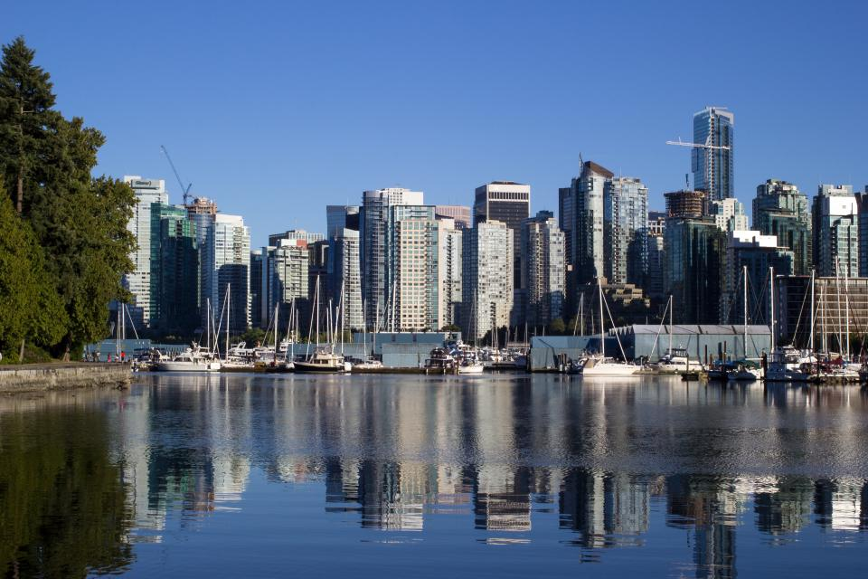 buildings skyline city urban water port boats docks towers architecture