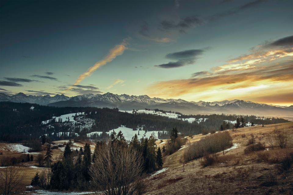 mountains cliffs hills peaks sunset sky clouds fields valleys snow trees bushes cold outdoors nature