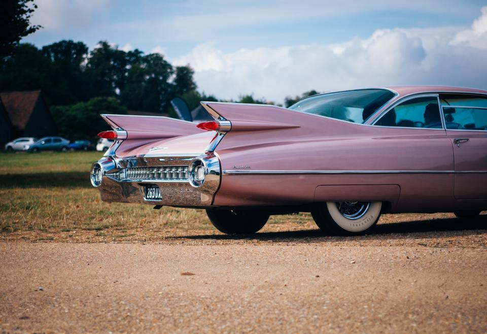 car vintage pink vehicle transportation travel vacation race clouds sky trees car show