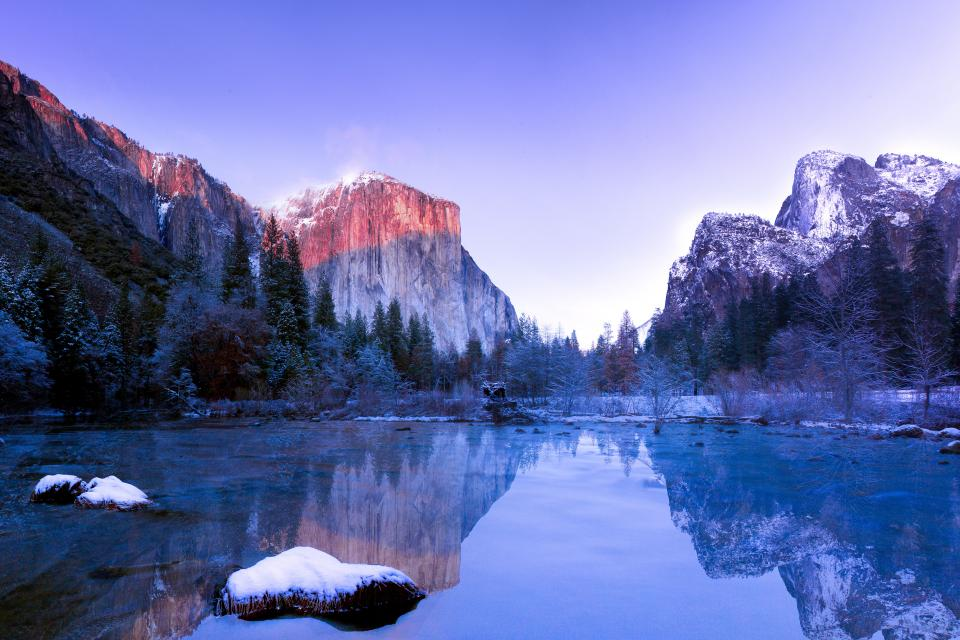 lake water snow winter cold rocks mountain summit peak hill landscape nature trees plant blue sky