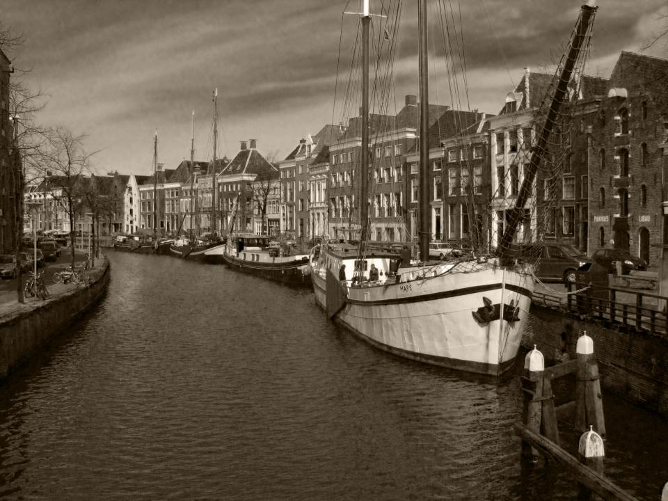 Netherlands city town buildings architecture sailboats river water
