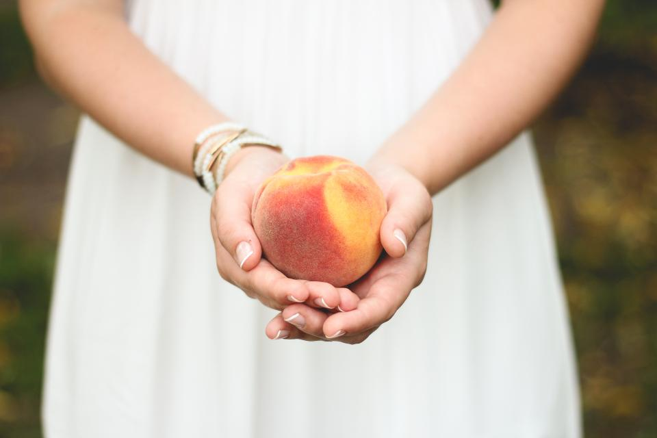 peach fruit hands