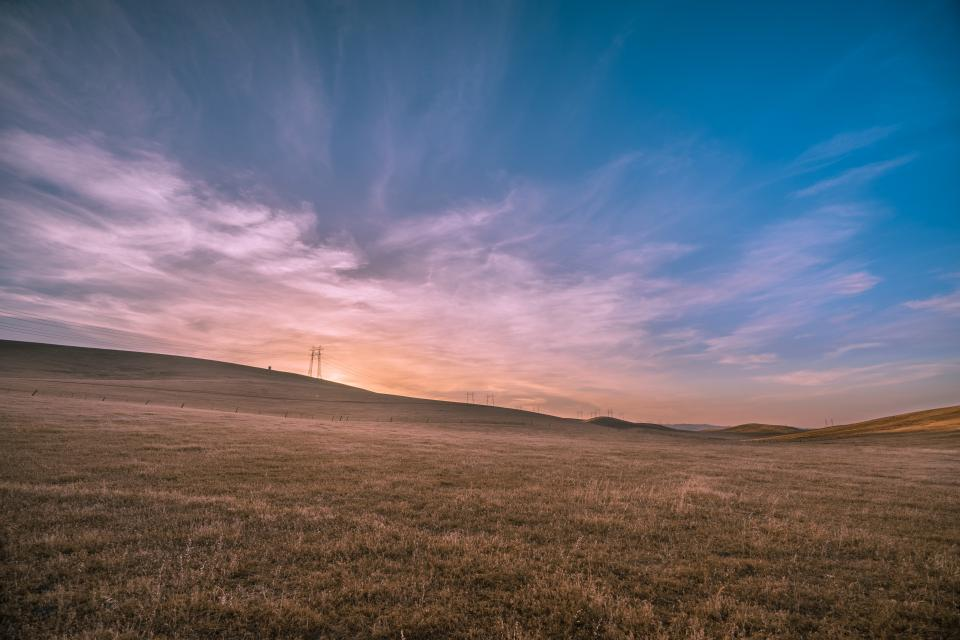 grass fields rural countryside nature sky clouds power lines landscape