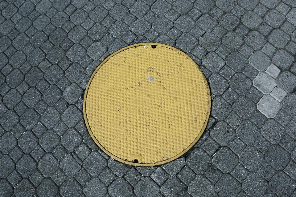 yellow manhole cobblestone pattern texture