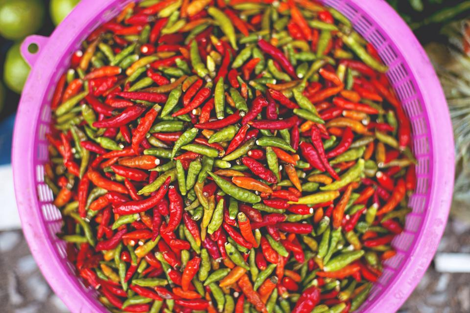 food spice red chili tub stack pile green top view still bokeh