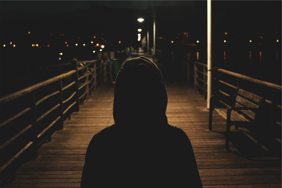 hoodie sweater dark night evening shadows people boardwalk pier