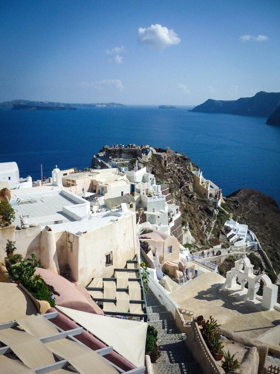Oia Santorini Greece buildings architecture city town coast water sea ocean mountains hills