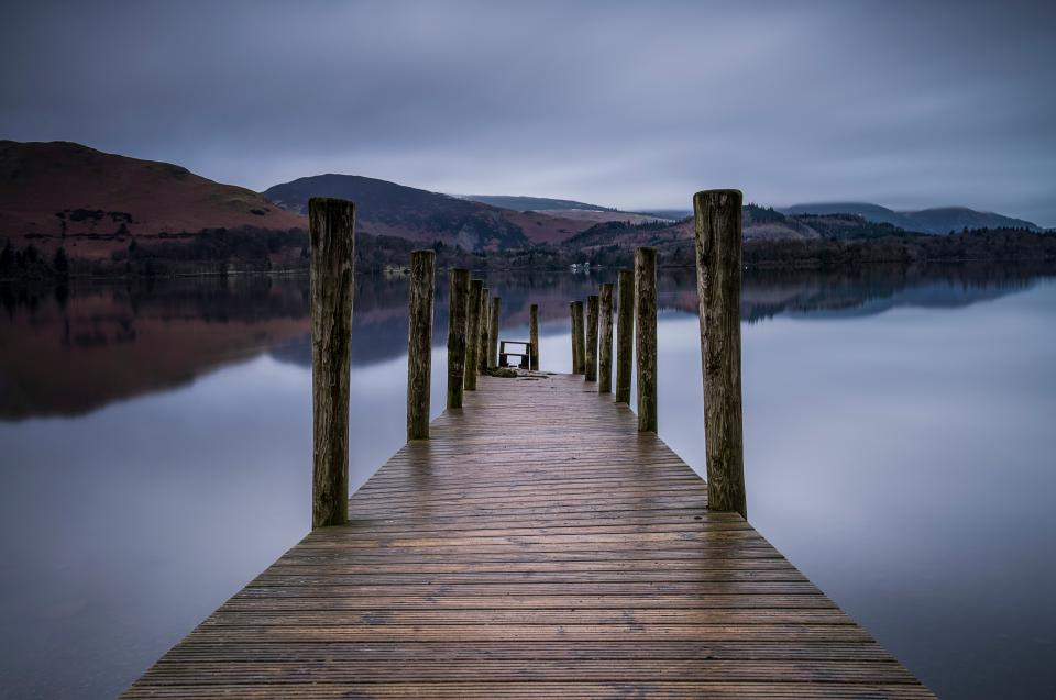 pier outdoor wood mountain gloomy sky lake water reflection