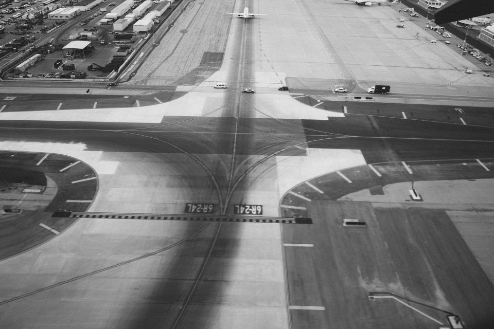 airport runway tarmac airplanes transportation travel black and white