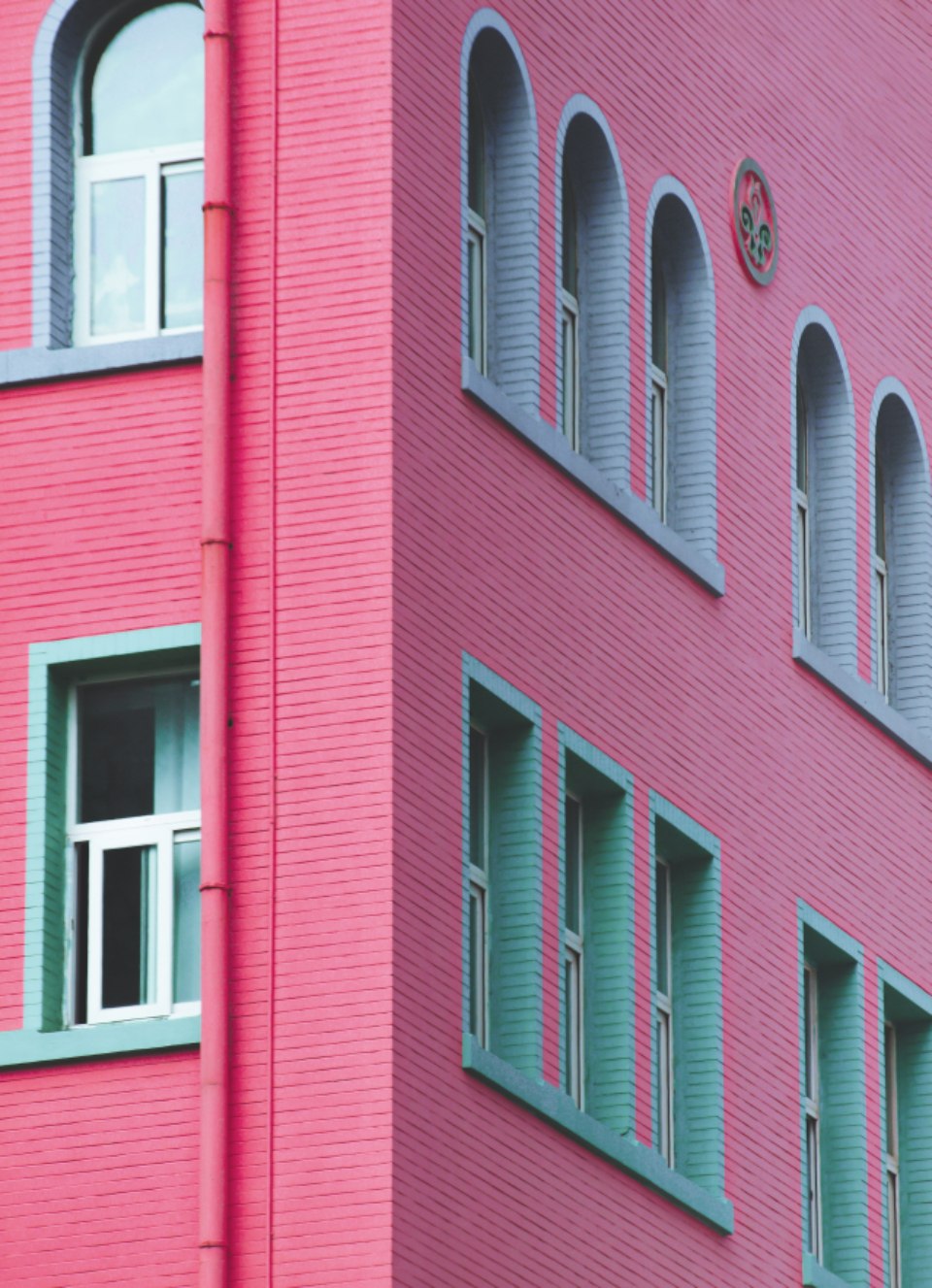 colorful exterior wall windows architecture color facade apartment building pastel pink brick painted classic design