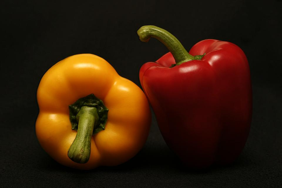 food cook spice ingredients red yellow bell peppers styling minimalist still bokeh
