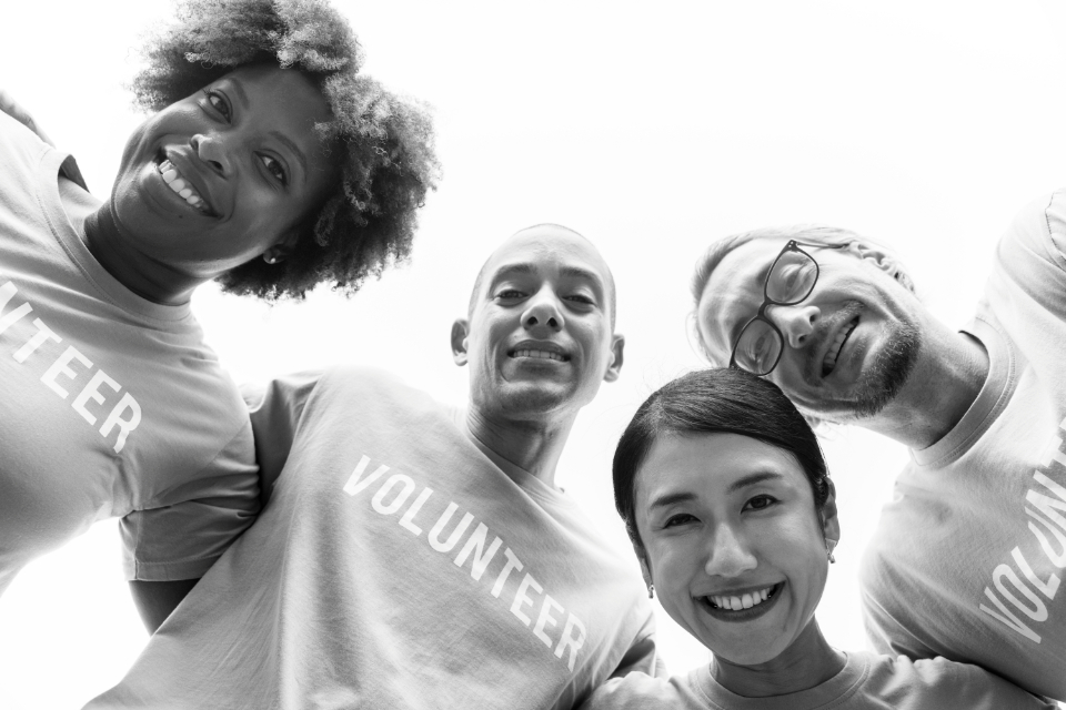 arms around charity cheerful community community service diverse donation european friends friendship grayscale group happiness help humanity japanese kindness korean man
