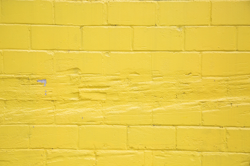 yellow brick wall texture exterior concrete weathered architecture background copyspace bricks painted pattern building wallpaper