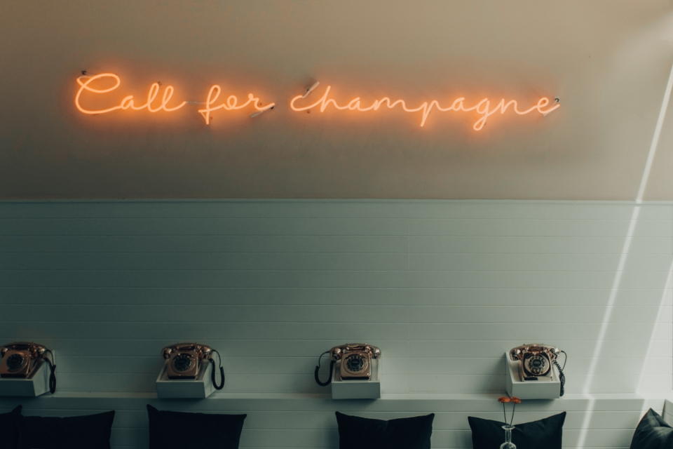 champagne neon sign typograpghy design telephone vintage old wall white