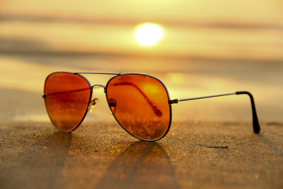 still items things sunglasses nature sand shore light shadows sun sunrise sunset sky clouds gradient beige yellow