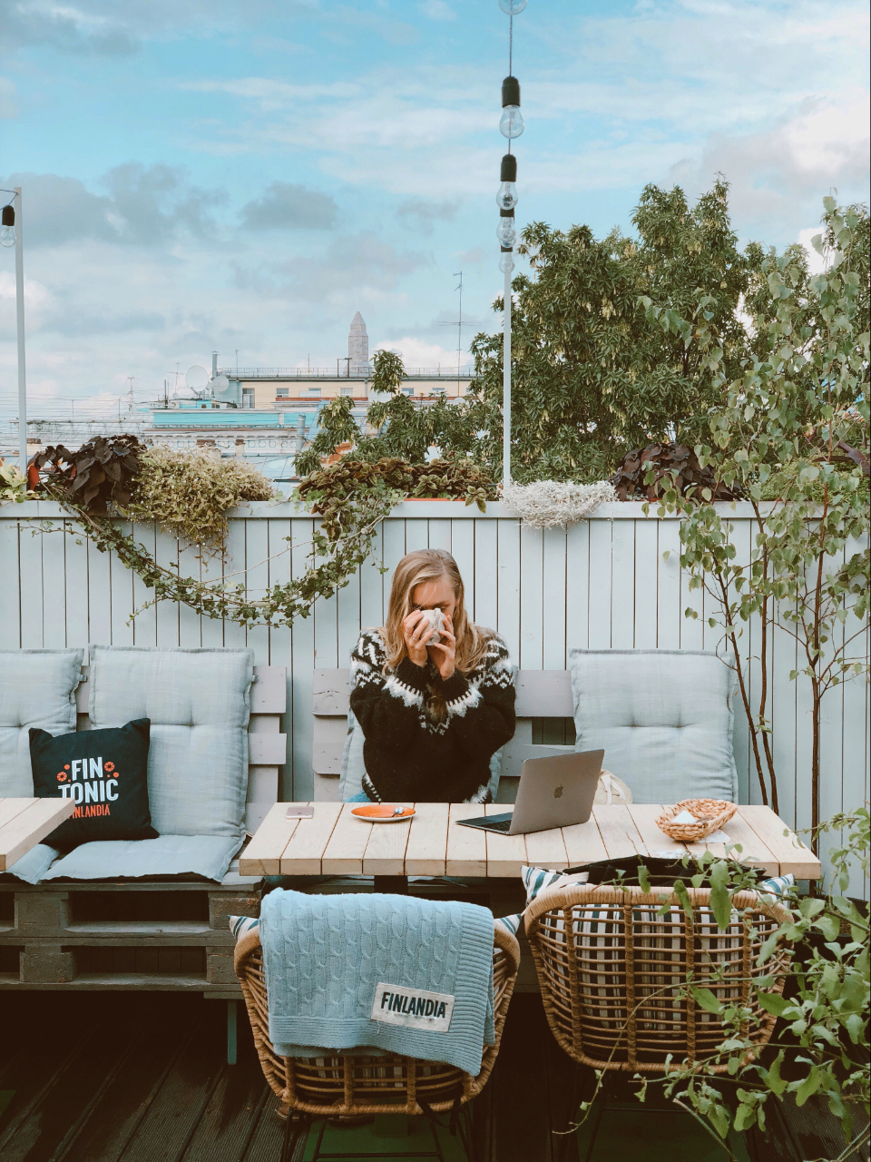 woman sipping tea seat sit cafe coffee drink food work office remote laptop blanket outside